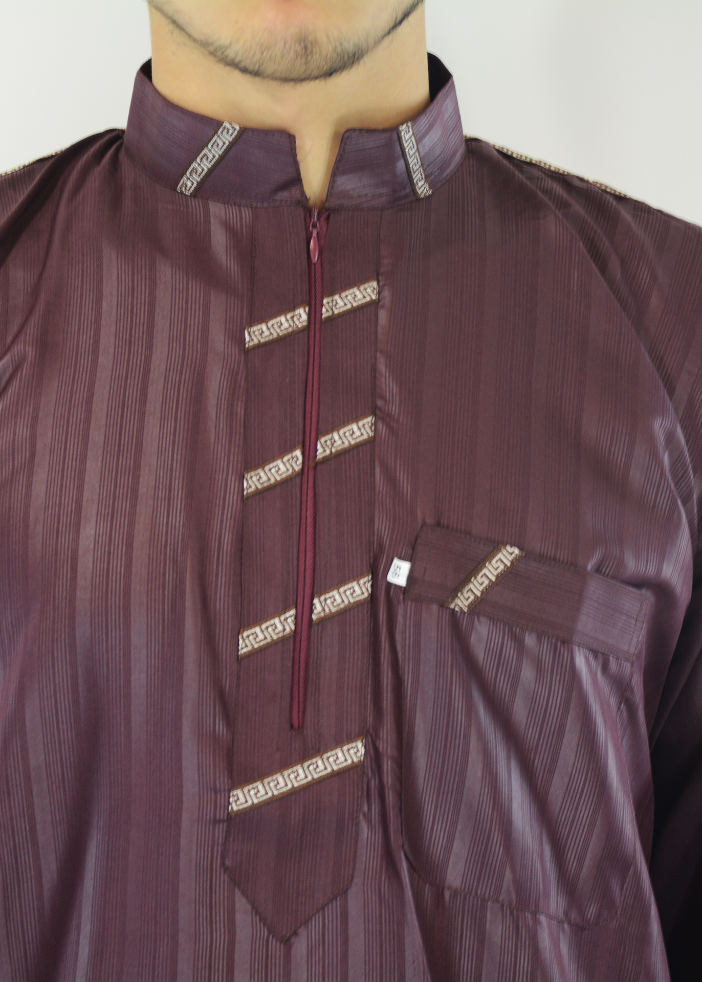 Amani Mens Thobe with Zipper up front and unique Embroidery closeup